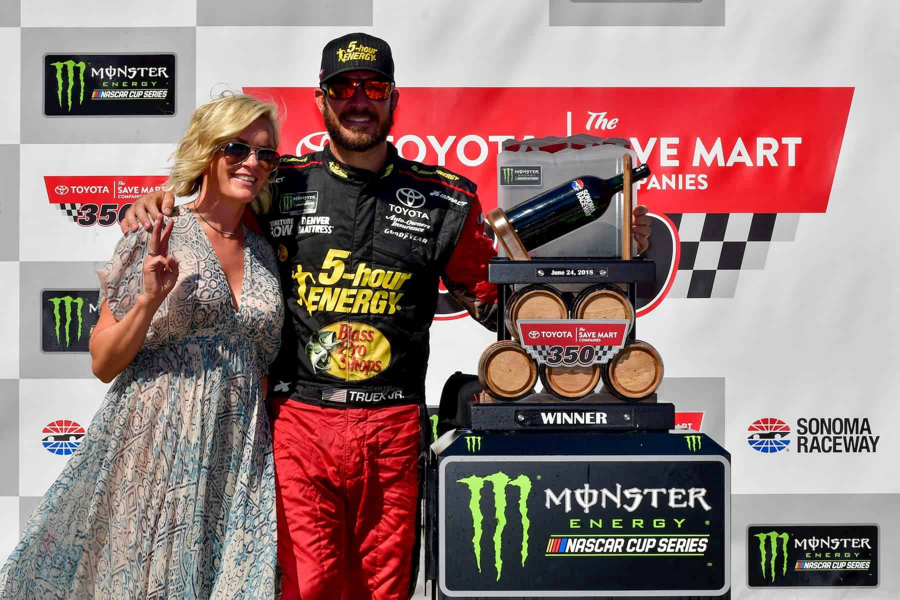Martin Truex Jr. and Sherry Pollex celebrate together in Victory Lane at Sonoma Raceway.