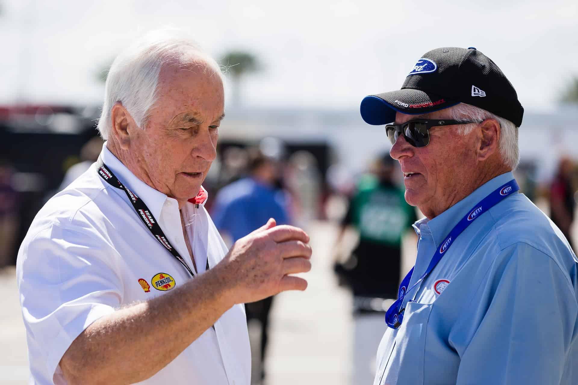 Roger Penske and Dale Inman talk at Daytona International Speedway in 2017. Photo by Nigel Kinrade Photography.
